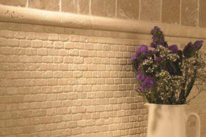 Travertin mosaik på køkken væggen
